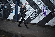 Black and white chevrons, stripes, graffiti along Brick Lane, London, UK.