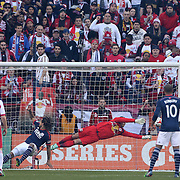 Goalkeeper Luis Robles makes a great save from a Jermaine Jones header during the New York Red Bulls Vs New England Revolution, MLS Eastern Conference Final, first leg at Red Bull Arena, Harrison, New Jersey. USA. 23rd November 2014. Photo Tim Clayton