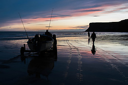 © Licensed to London News Pictures. <br /> 24/10/2014. <br /> <br /> Saltburn, United Kingdom<br /> <br /> A fishing boat and her crew prepare to head out at first light from the beach at Saltburn. The fishing fleet at Saltburn has declined over the years but there remains a small number of commercial and leisure fishing boats that still put out to sea from the town. <br /> <br /> Photo credit : Ian Forsyth/LNP