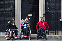 © licensed to London News Pictures. London, UK 27/02/2013. GB double gold medalist Hannah Cockroft (centre), Charlotte Moore (left), Joel Connor-Saunders (right) in Downing Street to promote 'Get Inspired' manifesto for a Paralympic legacy and improvement of opportunities for disabled people. Photo credit: Tolga Akmen/LNP