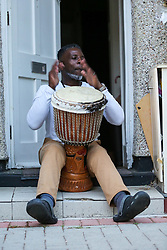 © Licensed to London News Pictures. 23/04/2020. London, UK. A man playing on a drum in Haringey, north London takes part in 'Clap For Our Carers' by applauding NHS staff, carers and key workers. The campaign has been encouraging people across the UK to take part in a round of applause from their windows, doors and front gardens to show their appreciation for the efforts of the NHS staff, carers and key workers during the COVID-19 pandemic. Photo credit: Dinendra Haria/LNP