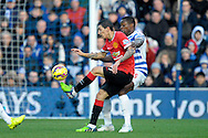 Angel Di Maria of Manchester United controlling the ball from Nedum Onuoha of QPR. Barclays Premier league match, Queens Park Rangers v Manchester Utd at Loftus Road in London on Saturday 17th Jan 2015. pic by John Patrick Fletcher, Andrew Orchard sports photography.