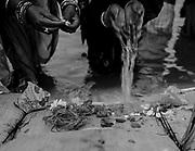 Women offer blessings at the Sangam, the confluence of the sacred rivers Ganga, Yamuna, and mythical Saraswati during the Kumbh Mela in Prayagraj, India.