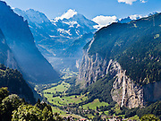 """The Lauterbrunnen Breithorn rises to 3780 meters or 12,402 feet elevation above Lauterbrunnen Valley, as seen from Wengernalpbahn cog train near Wengen, Switzerland, in the Alps, Europe. Staubbach Falls (Staubbachfall), the highest waterfall in Switzerland, plunges 1000 feet (300 meters) into Lauterbrunnen Valley in the Berner Oberland. The world's longest continuous rack and pinion railway (Wengernalpbahn) goes from Grindelwald up to Kleine Scheidegg and down to Wengen and Lauterbrunnen. The Bernese Highlands are the upper part of Bern Canton. UNESCO lists """"Swiss Alps Jungfrau-Aletsch"""" as a World Heritage Area (2001, 2007)."""