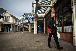 © Licensed to London News Pictures. 08/09/2020. Caerphilly, Wales, UK. A man checks his phone at almost 6pm at time the town of Caerphilly in south Wales, which has gone into lockdown along with it's wider borough area, after what is being described as a rapid increase in coronavirus cases. The Welsh government announced that from 6pm on Tuesday people will not be able to leave or enter the area without good reason, along with other restrictive measures.<br />  Photo credit: Robert Melen/LNP