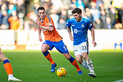 Matthew Kennedy (#33) of St Johnstone FC runs past Lee Wallace (#5) of Rangers FC during the Ladbrokes Scottish Premiership match between St Johnstone FC and Rangers FC at McDiarmid Park, Perth, Scotland on 23 December 2018.