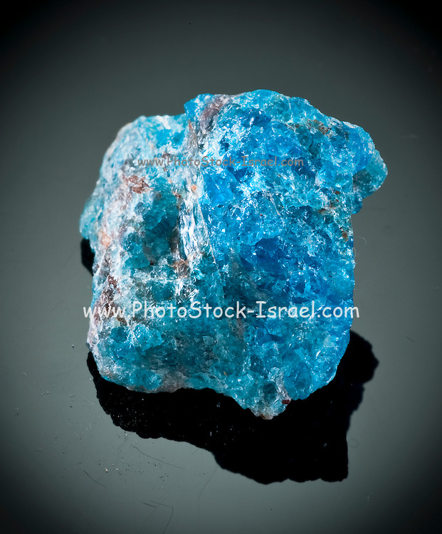 Cutout of a blue apatite gemstone on black background
