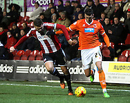 Gary Madine dribbling in a rare Blackpool attack during the Sky Bet Championship match between Brentford and Blackpool at Griffin Park, London, England on 24 February 2015. Photo by Matthew Redman.