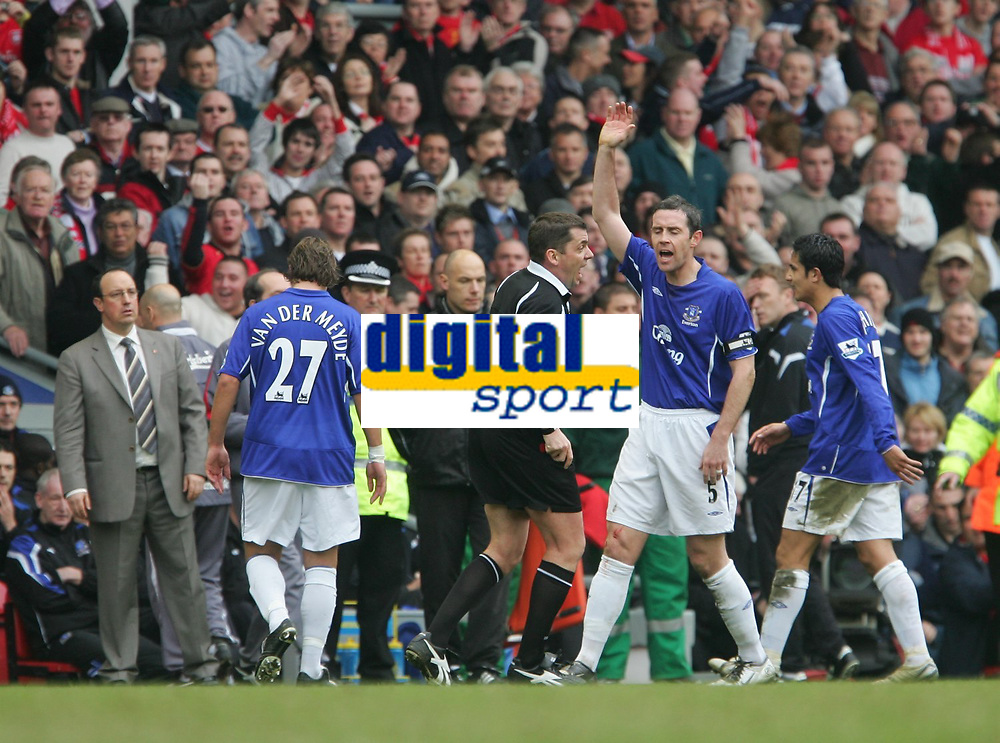 Photo: Andrew Unwin.<br />Liverpool v Everton. The Barclays Premiership. 25/03/2006.<br />Everton's David Weir (R) cannot believe it as his team-mate, Andy Van Der Meyde (L) is sent off.