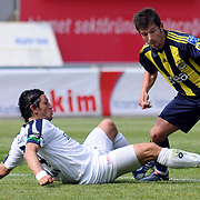 Kasimpasaspor's Emre TORAMAN (L) and Fenerbahce's Emre BELOZOGLU (R) during their Turkish superleague soccer match Kasimpasaspor between Fenerbahce at the Recep Tayyip Erdogan stadium in Istanbul Turkey on Sunday 25 April 2010. Photo by TURKPIX