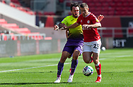Bristol City's Tommy Rowe (25) under pressure from Exeter City's Ryan Bowman (12) during the EFL Cup match between Bristol City and Exeter City at Ashton Gate, Bristol, England on 5 September 2020.