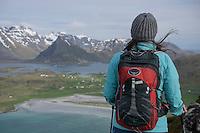 Female hiker with over Yttersand beach, Moskenesøy, Lofoten Islands, Norway