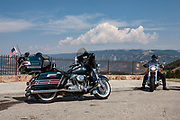 Harley Davidson motorcycles on the Chief Joseph Scenic Highway towards Cody, Wyoming. Bike touring is incredibly popular in and around Yellowstone National Park such as here.