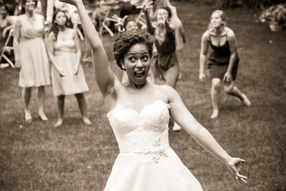 A bride tosses her bouquet in Brattleboro, VT.