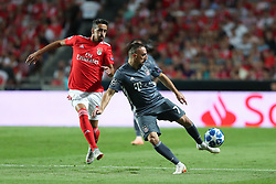 September 19, 2018 - Lisbon, Portugal - Bayern Munich's midfielder Franck Ribery from France (R ) vies with Benfica's Portuguese defender Andre Almeida during the UEFA Champions League Group E football match SL Benfica vs Bayern Munich at the Luz stadium in Lisbon, Portugal on September 19, 2018. (Credit Image: © Pedro Fiuza/NurPhoto/ZUMA Press)