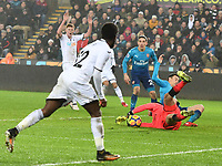 Football - 2017 / 2018 Premier League - Swansea City vs. Arsenal<br /> <br /> Petr Cech of Arsenal saves a shot from Nathan Dyer of Swansea City, at The Liberty Stadium.<br /> <br /> COLORSPORT/WINSTON BYNORTH