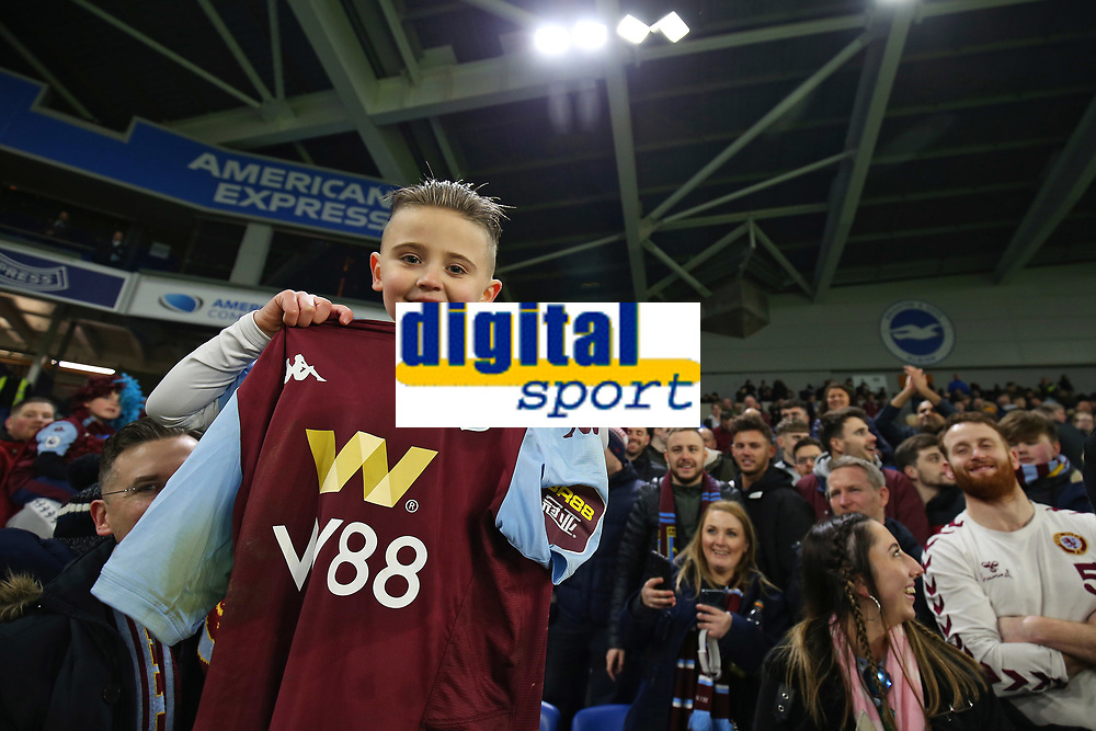 Football - 2019 / 2020 Premier League - Brighton & Hove Albion vs. Aston Villa<br /> <br /> A young Jack Grealish look alike holds up his heroes shirt after the real Villa captain spotted him in the crowd and gave him his shirt and captains armband after the draw at The Amex Stadium Brighton <br /> <br /> COLORSPORT/SHAUN BOGGUST