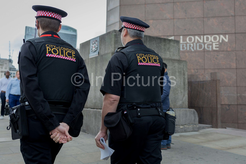36 hours after the London Bridge and Borough Market terrorist attack, the capital returns to normality and Londoners return to their first day to work and a very visible police presence is evident, on Monday 5th June 2017, in the south London borough of Southwark, England. Seven people were killed and many others left with life-changing injuries - but the British spirit of defiance and to carry on with every day life, endures.
