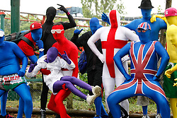 © licensed to London News Pictures. Tamworth/Staffordshire, UK  07/05/2011. Morphsuit challenge to break the Guiness World Record at Drayton Manor Park, Tamworth, Staffs. Please see special instructions for usage rates. Photo credit should read Dave Warren/LNP