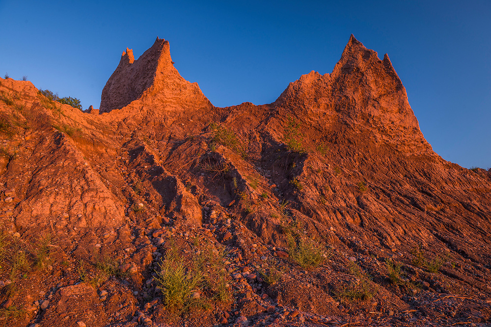 Eroded Red rock shapes in late evening light, summer, Chimney Bluffs State Park, Huron, NY