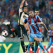 Trabzonspor's Burak YILMAZ (R) during their UEFA Champions League third qualifying round, second leg, soccer match Trabzonspor between Benfica at the Ataturk Olimpiyat Stadium at İstanbul Turkey on Wednesday, 03 August 2011. Photo by TURKPIX