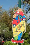 Israel, Tel Aviv, Purim Celebration a clown sign