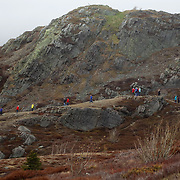 Members of a tour group hike along a hill on Signal Hill St. John's, Newfoundland and Labrador, Canada, on Thursday, June 6, 2019. THE BLADE/KURT STEISS <br /> MAG NewfoundlandXX