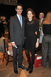 JAMES & SASKIA PEILL at a party to celebrate the publication of The irish Country House written by The Knight of Glin and James Peill with photographs by James Fennell, held at Christie's, King Street, London on 24th January 2011.