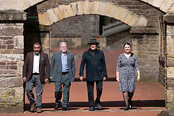 Lanark, Scotland, UK. 15 April 2021. George Galloway and candidates for the All for Unity party (formerly Alliance for Unity)  make live streamed campaign speeches ahead fo Scottish election at New Lanark conservation village in Lanark today. Pic ; Candidates L to R Khalid Mohammed, Matt Alexander, George Galloway, Mary Devlin.   Iain Masterton/Alamy Live News