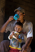 José Angel Galaviz Carrillo, a rancher of Pima heritage, having tea with his son Favien at their home in the Sierra Mountains, near Maycoba, in the Mexican state of Sonora.  (José Angel Galaviz Carrillo is featured in the book What I Eat: Around the World in 80 Diets.)
