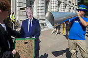 Pro remain campaigner Steve Bray shouts through a megaphone at a cardboard cut out of Prime Minister Boris Johnson outside the Cabinet office in Whitehall, London, United Kingdom on 22nd August 2019. Inside ministers are discussing Brexit at a daily Brexit Cabinet Meeting.