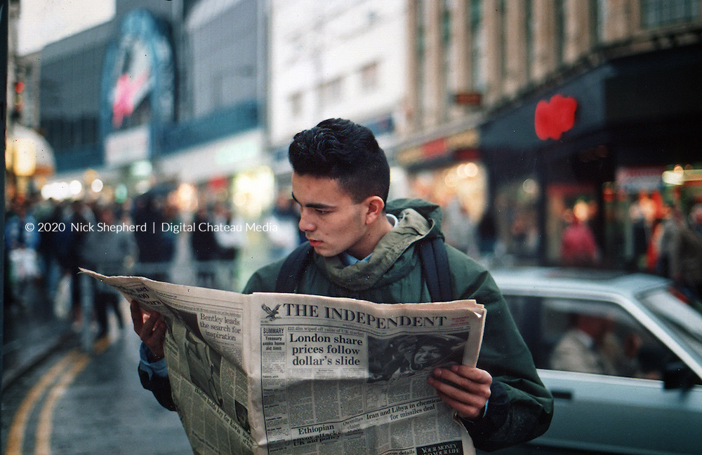 Andy reading the new Independant Newspaper in Bournemouth Square circa 1988-89, shot on Canon Eos 100 and Agfa film - scanned to digital format.<br /> Scene is looking up Commercial Rd towards the Triangle.