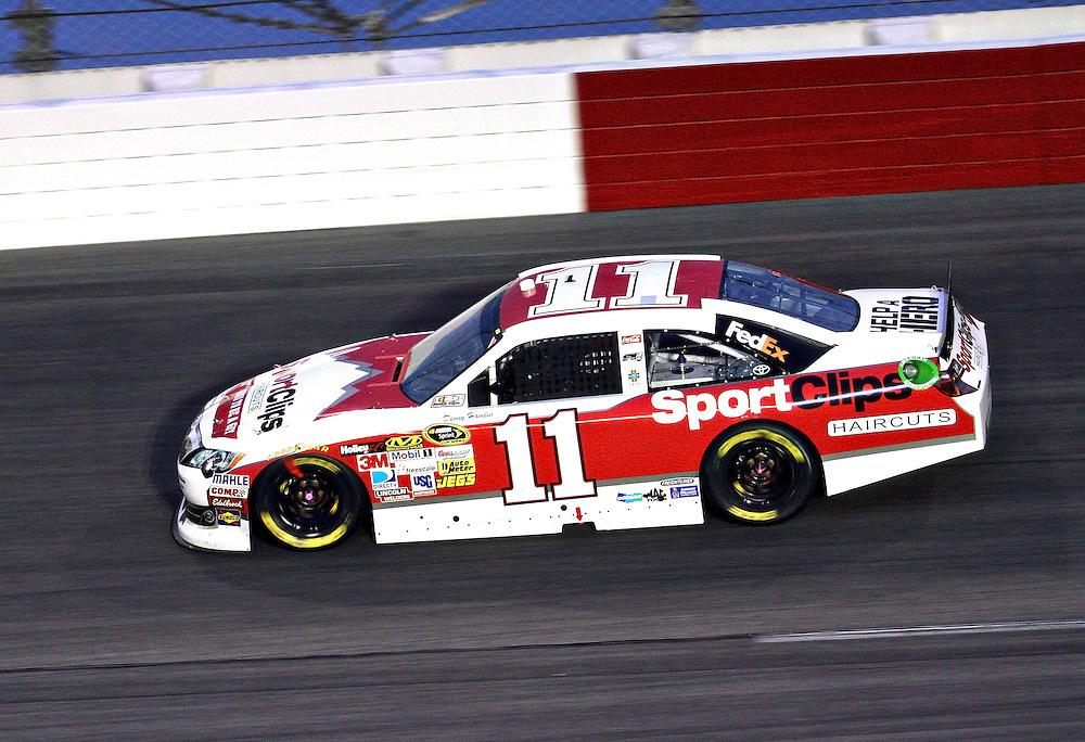 May 12, 2012; Darlington, SC, USA; NASCAR Sprint Cup driver Denny Hamlin (11) during the Southern 500 at Darlington Raceway. Mandatory Credit: Peter Casey-US PRESSWIRE.