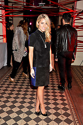 MOLLIE KING at the Tunnel of Love art and fashion auction and dinner in aid of the British Heart Foundation held at One Mayfair, London on 12th November 2013.