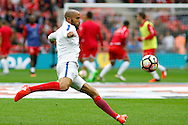 England Midfielder Andros Townsend warms up before kick off during the FIFA World Cup Qualifier match between England and Malta at Wembley Stadium, London, England on 8 October 2016. Photo by Andy Walter.