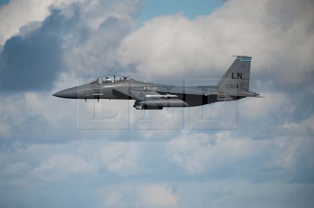 © Licensed to London News Pictures. 08/03/2014. The US Air Force has deployed fighter jets and military personnel to Lithuania and plans to increase its military presence in Poland. The move comes as concern over Russia's intervention in Ukraine is rising across the region. FILE PICTURE dated 2010: A F-15C Eagle fighter jet on a training exercise over North Wales. Photo credit : Andrew Chittock/LNP