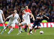 Scotland's Shaun Maloney tussles with England's Stewart Downing<br /> <br /> - International Friendly - Scotland vs England- Celtic Park - Glasgow - Scotland - 18th November 2014  - Picture David Klein/Sportimage