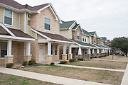An exterior view of the Wahoo Frazier Townhomes in Dallas, Texas on January 21, 2015. (Cooper Neill for The New York Times)
