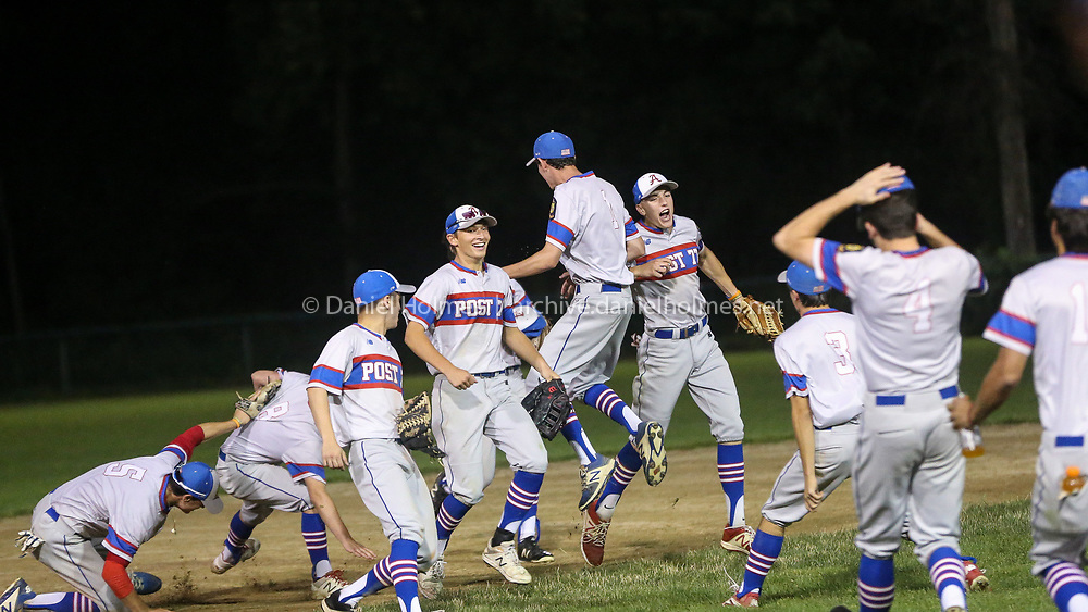 (7/24/19, NATICK, MA) Ashland Post 77' celebrates their win over Lowell in the Zone 5 championship game at Mahan Field  in Natick on Wednesday. [Daily News and Wicked Local Photo/Dan Holmes]