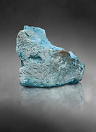Ancient Egyptian fragment of blue pigment,  19-20th Dynasty (1292-1076 BC, Deir el-Medina. Egyptian Museum, Turin. Schiaparelli Cat 9929. Grey background .<br /> <br /> If you prefer to buy from our ALAMY PHOTO LIBRARY  Collection visit : https://www.alamy.com/portfolio/paul-williams-funkystock/ancient-egyptian-art-artefacts.html  . Type -   Turin   - into the LOWER SEARCH WITHIN GALLERY box. Refine search by adding background colour, subject etc<br /> <br /> Visit our ANCIENT WORLD PHOTO COLLECTIONS for more photos to download or buy as wall art prints https://funkystock.photoshelter.com/gallery-collection/Ancient-World-Art-Antiquities-Historic-Sites-Pictures-Images-of/C00006u26yqSkDOM