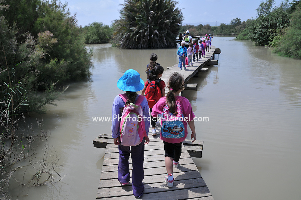 Israel, Northern District Ein Afek Nature Reserve on the Naaman River a group of children on a field trip