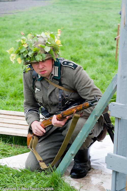 A Re-enactor portrayiing a German panzergrenadier from the Grossdeutschland Diviision during a battle battle re-enactment in on Pickering Showground<br /> <br /> 17/18 October 2015<br />  Image © Paul David Drabble <br />  www.pauldaviddrabble.co.uk