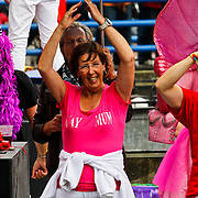 NLD/Amsterdam/20100807 - Boten tijdens de Canal Parade 2010 door de Amsterdamse grachten. De jaarlijkse boottocht sluit traditiegetrouw de Gay Pride af. Thema van de botenparade was dit jaar Celebrate, politicus Annemarie Jorritsma