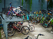 11 DECEMBER 2018 - SINGAPORE:  Bike parking the Geylang neighborhood. The Geylang area of Singapore, between the Central Business District and Changi Airport, was originally coconut plantations and Malay villages. During Singapore's boom the coconut plantations and other farms were pushed out and now the area is a working class community of Malay, Indian and Chinese people. In the 2000s, developers started gentrifying Geylang and new housing estate developments were built.      PHOTO BY JACK KURTZ