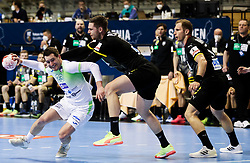 Miha Zarabec of Slovenia vs Hendrik Pekeler of Germany during handball match between National Teams of Germany and Slovenia at Day 2 of IHF Men's Tokyo Olympic  Qualification tournament, on March 13, 2021 in Max-Schmeling-Halle, Berlin, Germany. Photo by Vid Ponikvar / Sportida