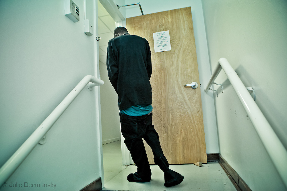 December 26th 2011, New Orleans, A suspect, who lost his shoes while being  chased by Officer DeSalvo, walks through the 5th precinct with the cuffs of his low-hanging pants tied around his feet.New Orleans crime rate is among the highest in America and is considered to be one of the most dangerous cities in the world.
