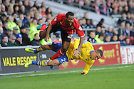 Kevin Theophile-Catherine of Cardiff City is tackled by Kieran Gibbs of Arsenal.<br /> Barclays Premier League match, Cardiff city v Arsenal at the Cardiff city stadium in Cardiff, South Wales on Saturday 30th Nov 2013. pic by Phil Rees, Andrew Orchard sports photography,