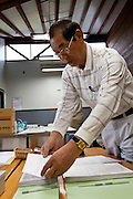 Isao Sanno files the results of food samples at the Becquerel Centre in a farmers' market in Miharu, where locally grown food is tested for nuclear contamination. Miharu, Fukushima, Japan. Friday May 4th 2012
