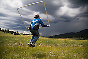 Raphael Perea, a high school biology intern at the Valles Caldera National Preserve, New Mexico, celebrates a developing storm by jump-roping his survey quadrat on July 18, 2006. The preserve's field crew, responsible for rangeland monitoring, is often forced to leave work early during monsoon season, chased out by the second highest incidence of lightning strikes in the country.