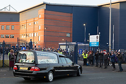© Licensed to London News Pictures. 30/01/2018. The funeral of footballer Cyrille Regis took place in West Bromwich today. The hearse made it's way past the football ground where he played as family, friends and fans said their final farewell. Pictured, the hearse arrives at the Hawthorns. Photo credit: Dave Warren/LNP